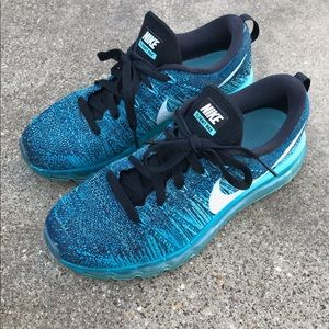 Blue women's Nike Flyknit Max sneakers.